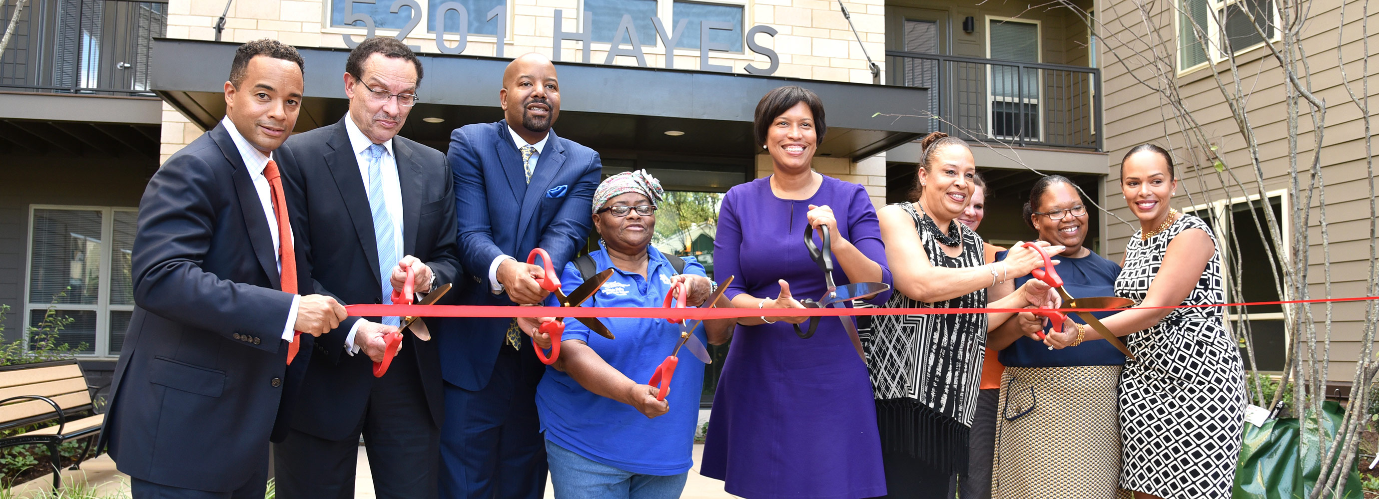 Ribbon cutting in front of 5201 HAYES