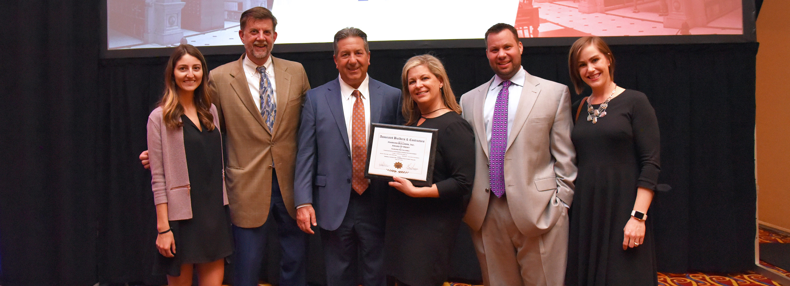 Harkins accepting award of Merit for HQ office