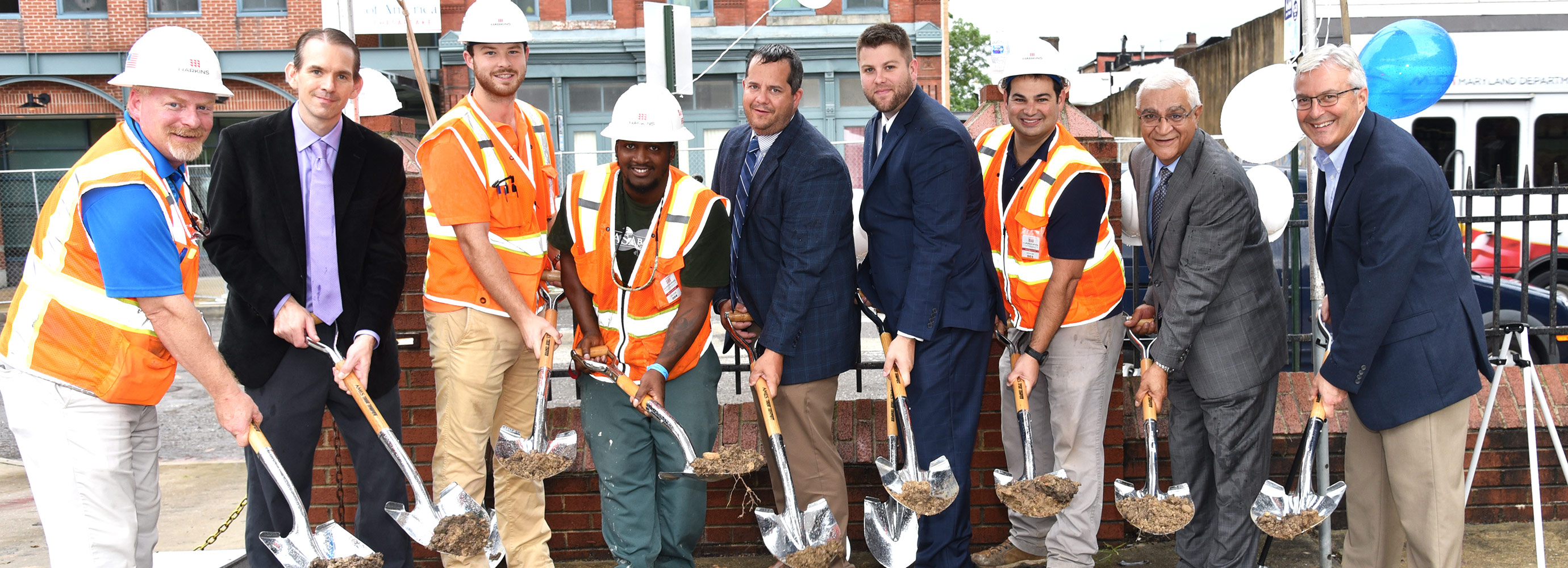 Side by side with shovels in hand for Paca House Renovation project groundbreaking