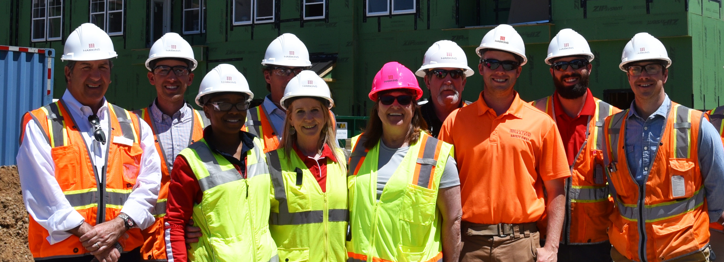 Smiling faces and construction hats on site at Community Parc