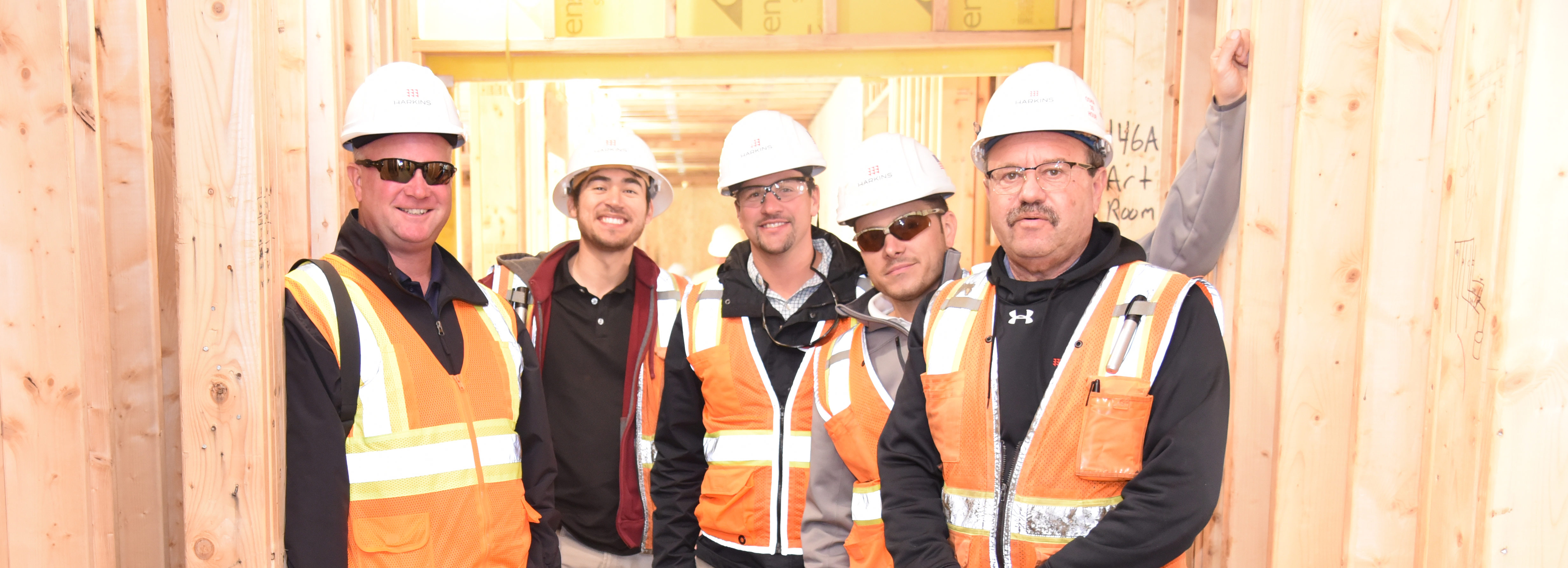 Group photo topping out construction framing