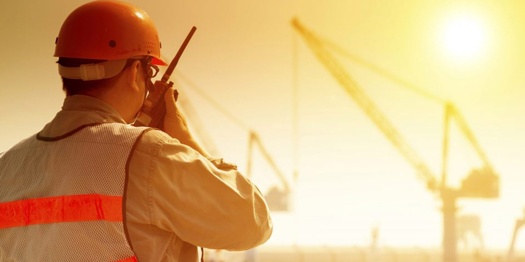 Construction worker monitors team for high-heat exposure