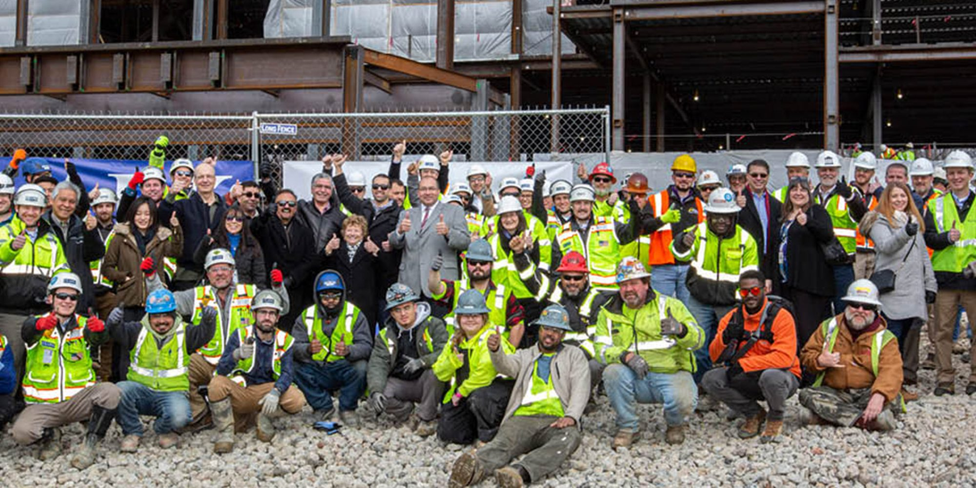 Clark Construction, Harkins, and trades gather to celebrate topping out of courthouse building