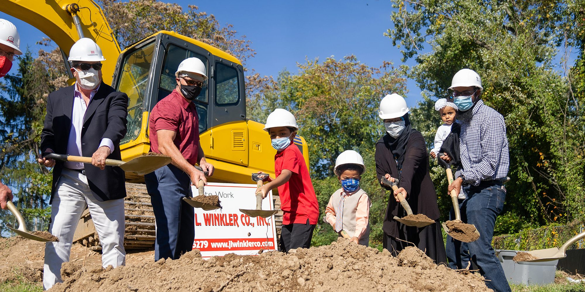 Harkins and Habitat break ground on home in Woodbourne-McCabe