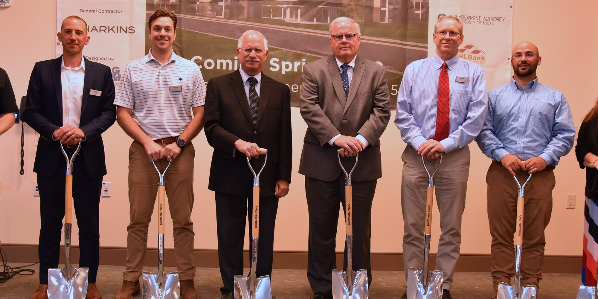 Harkins Members standing side by side at the Sellersville Groundbreaking with shovels in hand.