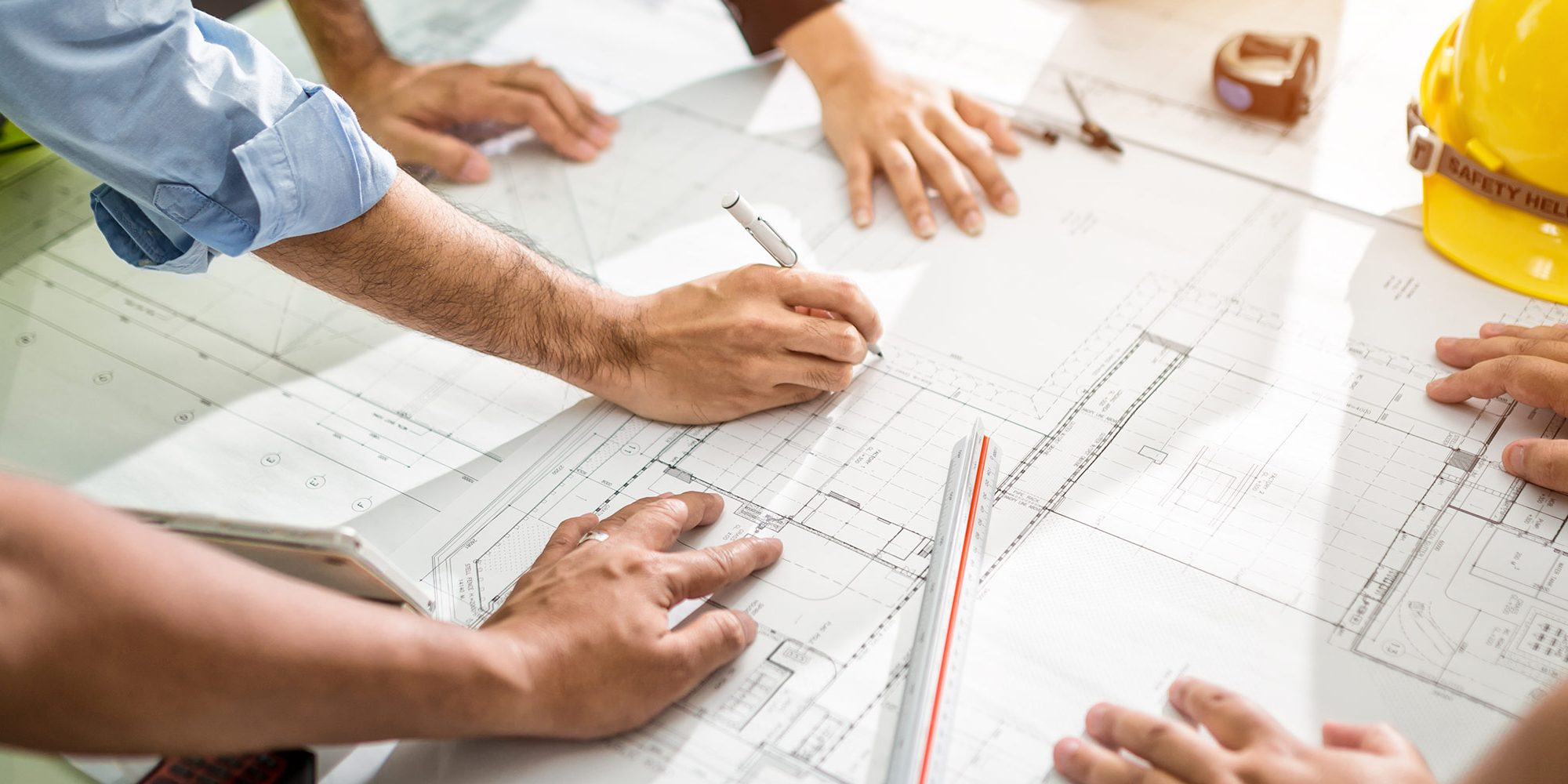 Team looking at drawings in preconstruction meeting